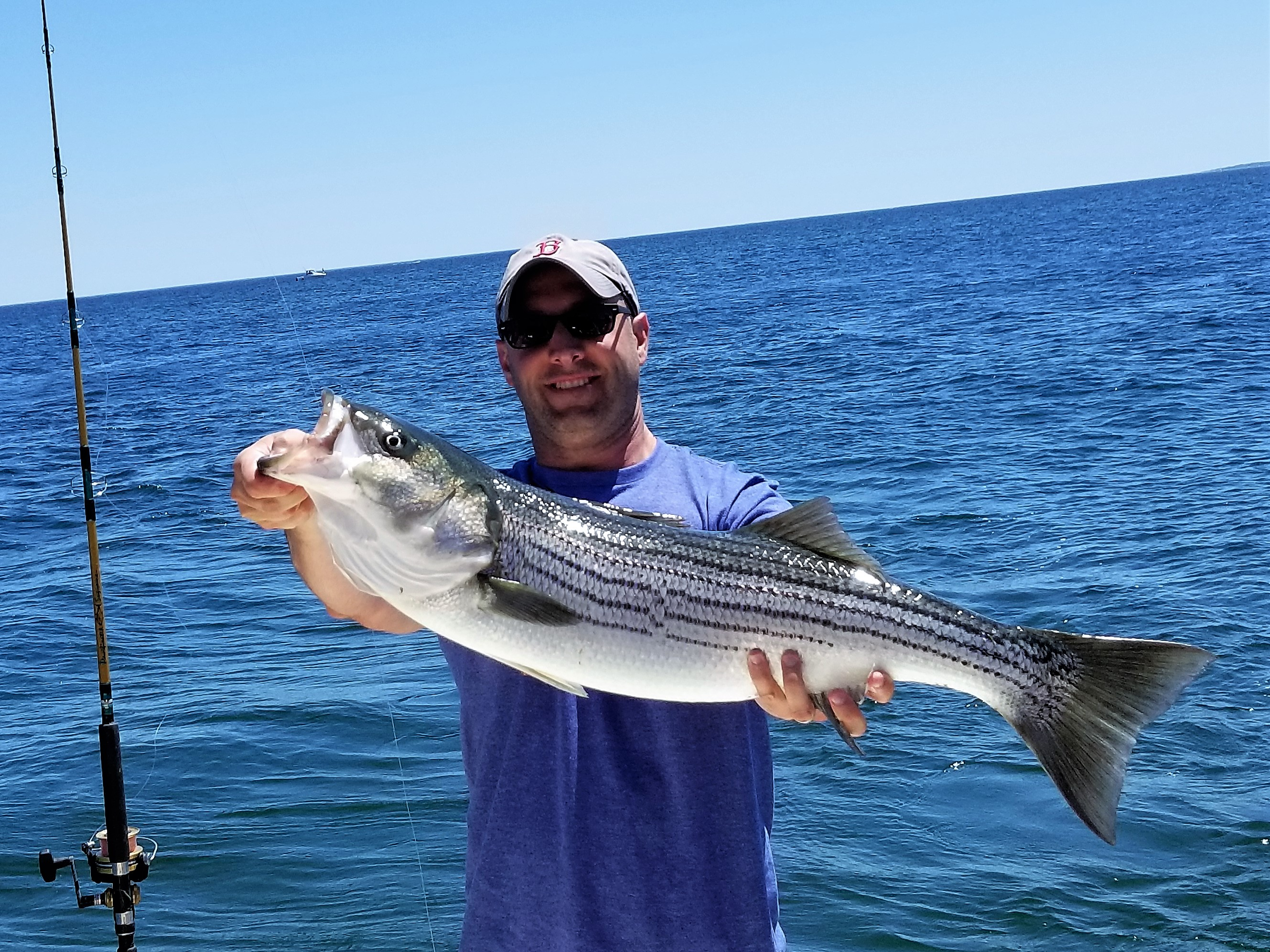 Nick w 33in Striper on Tuna Hunter