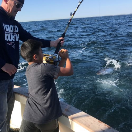 Father and Son Tuna Fishing on Tuna Hunter